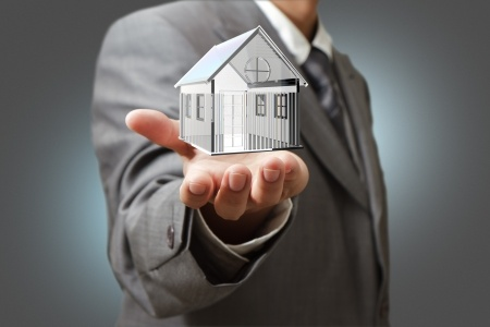 man-holding-out-hand-house