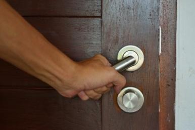 hand-opening-doorknob